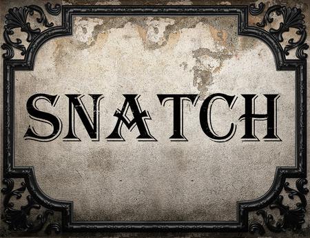 snatch: snatch word on concrette wall