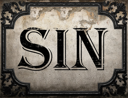 sin: sin word on concrette wall