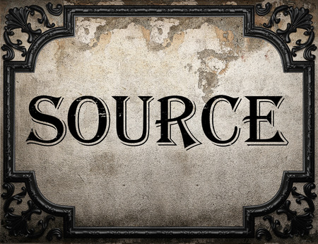source of iron: source word on concrette wall Stock Photo