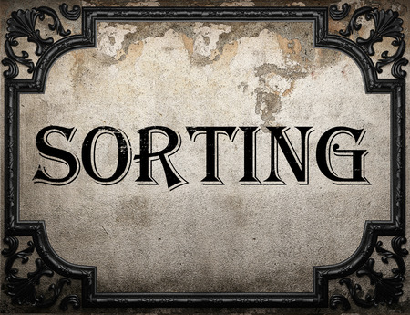 sorting: sorting word on concrette wall