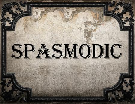 spasmodic: spasmodic word on concrette wall Stock Photo
