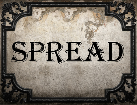 spread the word: spread word on concrette wall Stock Photo