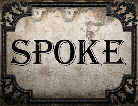 spoke: spoke word on concrette wall