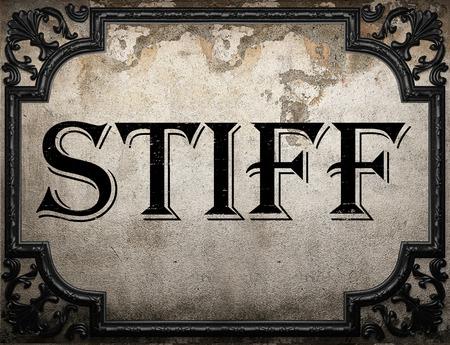 stiff: stiff word on concrette wall