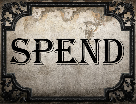 spend: spend word on concrette wall Stock Photo