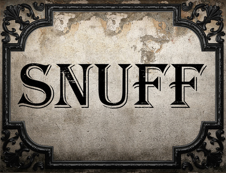 tabaco: snuff word on concrette wall Foto de archivo