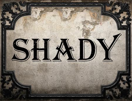 shady: shady word on concrette wall