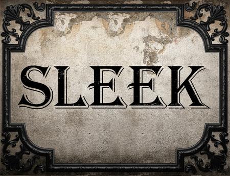 sleek: sleek word on concrette wall