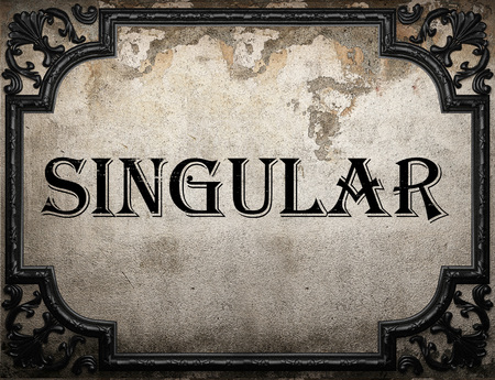 singular: singular word on concrette wall Stock Photo