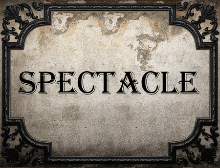spectacle: spectacle word on concrette wall Stock Photo