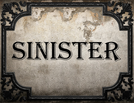 sinister: sinister word on concrette wall