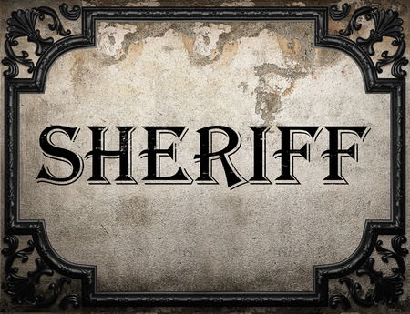 sheriff word on concrette wall