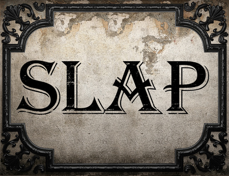 slap: slap word on concrette wall