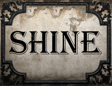 shine: shine word on concrette wall