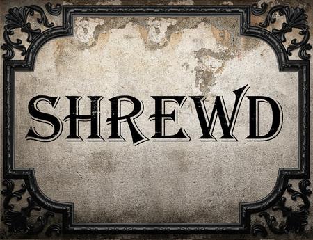shrewd: shrewd word on concrette wall