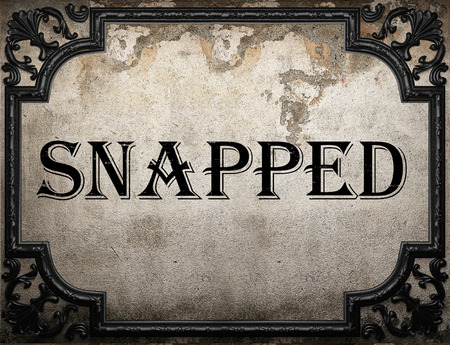 snapped: snapped word on concrette wall Stock Photo