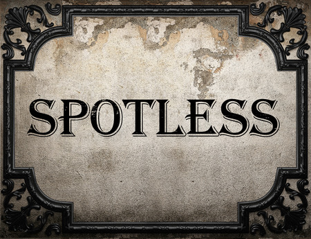 spotless: spotless word on concrette wall