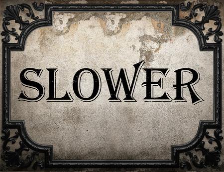 slower: slower word on concrette wall