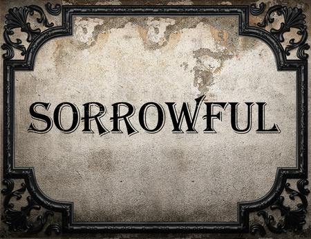 sorrowful: sorrowful word on concrette wall