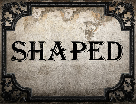 shaped: shaped word on concrette wall