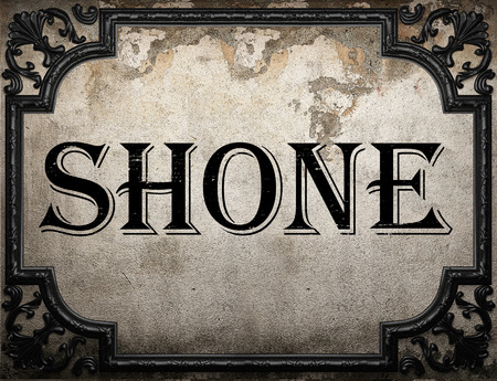 are shone: shone word on concrette wall