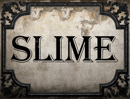 slime: slime word on concrette wall