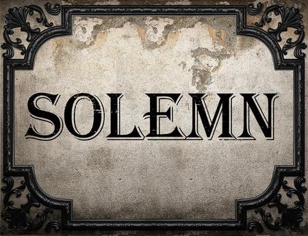 solemn: solemn word on concrette wall