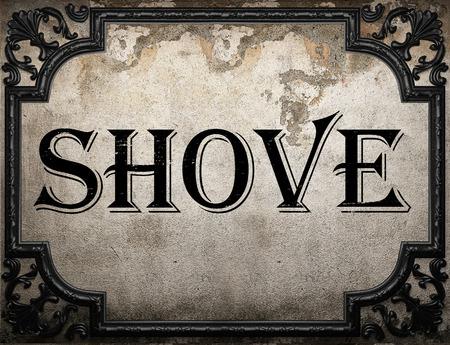 shove: shove word on concrette wall Stock Photo