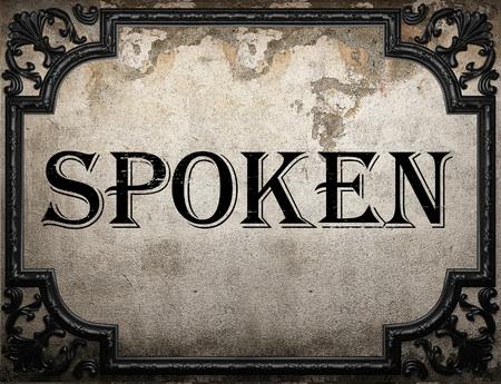 spoken: spoken word on concrette wall Stock Photo