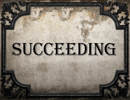 succeeding: succeeding word on concrette wall Stock Photo