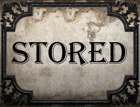 stored: stored word on concrette wall