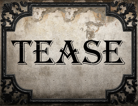 to tease: tease word on concrette wall