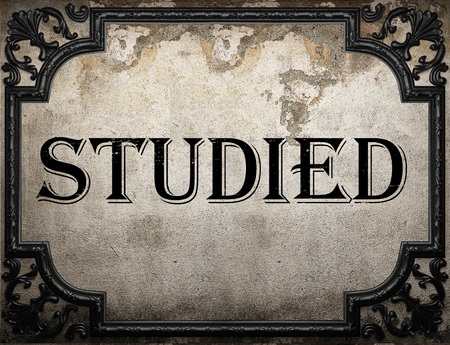 studied: studied word on concrette wall Stock Photo