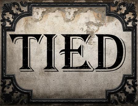 gefesselt: tied word on concrette wall