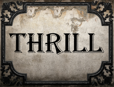 thrill: thrill word on concrette wall Stock Photo