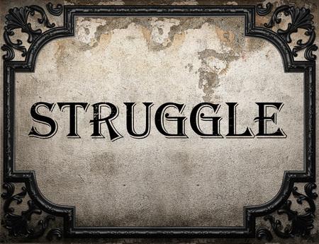 struggle: struggle word on concrete wall