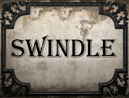 swindle: swindle word on concrete wall