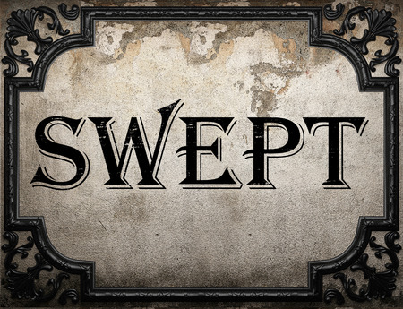 swept: swept word on concrete wall