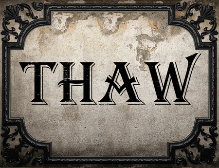thaw: thaw word on concrete wall