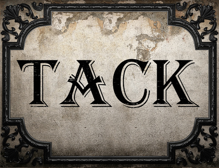 tack: tack word on concrete wall