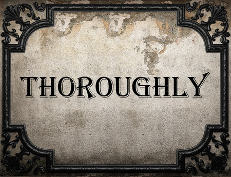 thoroughly: thoroughly word on concrete wall Stock Photo