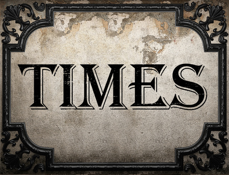 time's: times word on concrete wall Stock Photo
