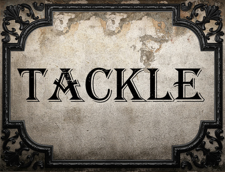 tackle: tackle word on concrete wall