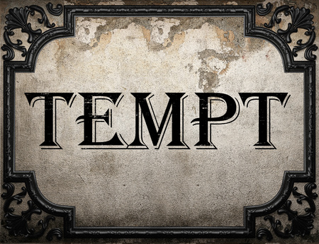 to tempt: tempt word on concrete wall Stock Photo