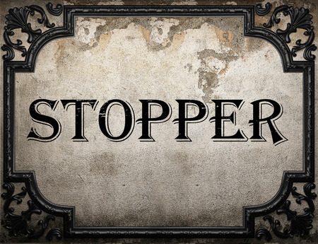 stopper: stopper word on concrete wall