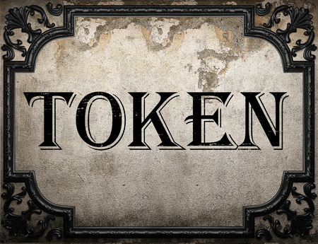 token word on concrete wall