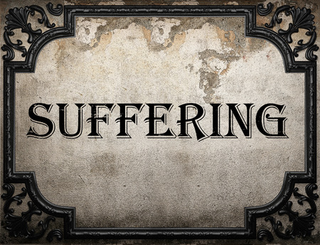 suffering: suffering word on concrete wall