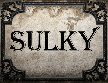 sulky: sulky word on concrete wall