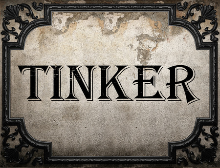 to tinker: tinker word on concrete wall