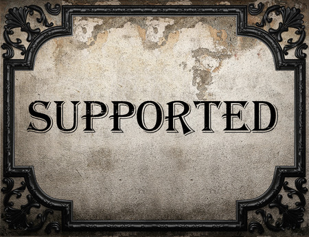 supported: supported word on concrete wall Stock Photo